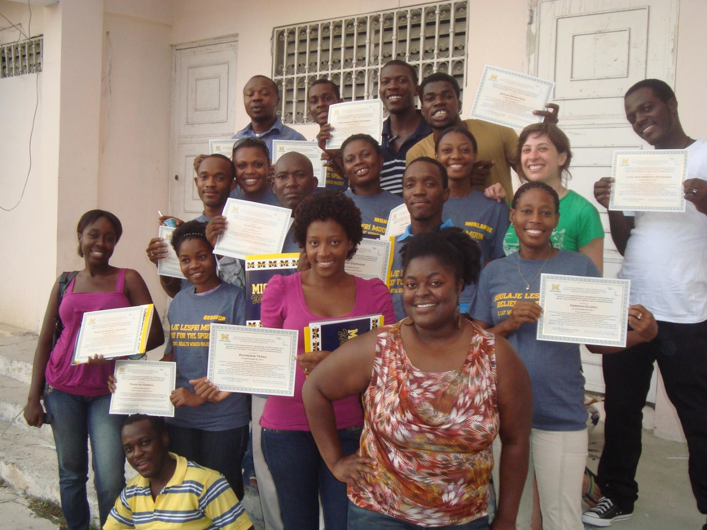 SLM staff receiving certificates of completion following training session